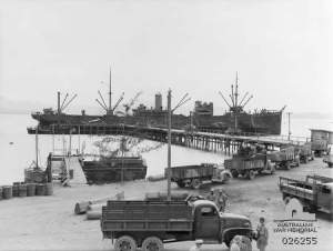 Cargo ship being unloaded at Port Moresby August 1942